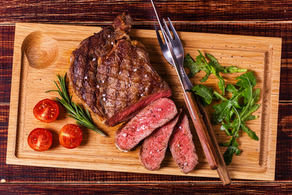 Image of a delicious Fareway Meat Market cooked steak on a cutting board.