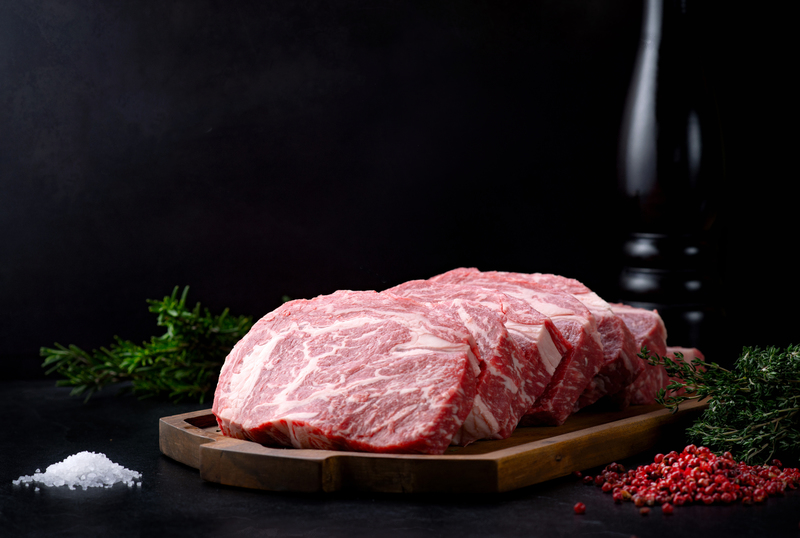 Image of the raw meat in the 12 oz. Prime Ribeye Steak Bulk Package.