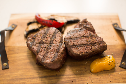 Image of two cooked beef tenderloin steaks.