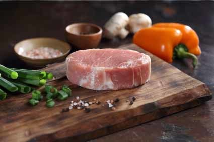 Image of a raw 8 oz. American Cut Pork Chop.