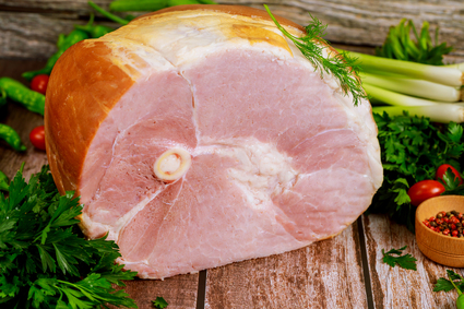 Image of the Fareway berkshire bone-in half ham cut in half.