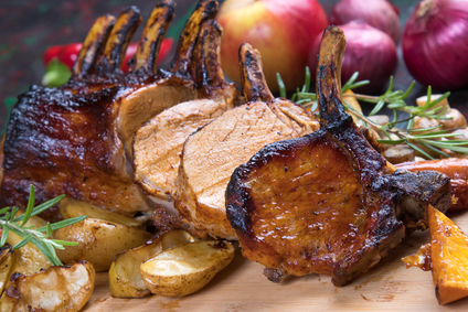 Image of a cooked pork rack in the DUROC Tomahawk Pork Chop Bulk Package.