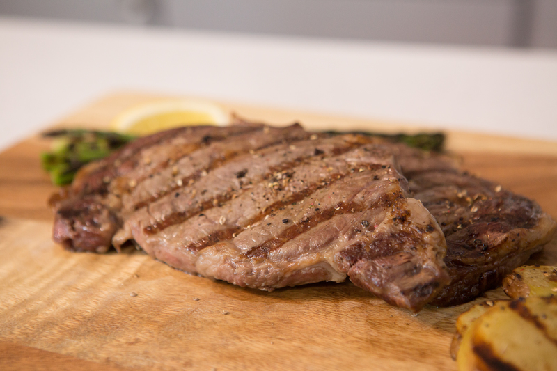 Image of a cooked 8 oz. Ribeye Steak.