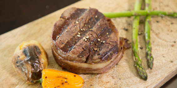Image of a Prime 8 oz. Filet Mignon with asparagus on the side.