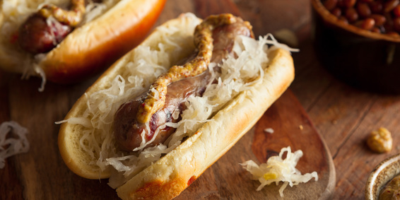 Image of an original Fareway skinless bratwurst on a bun.